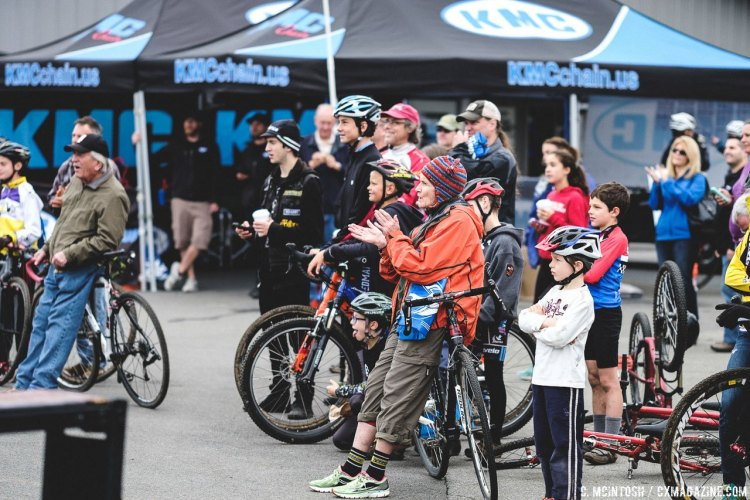 A crowd forms to cheer on a trials rider doing stunts. 2016 KMC Cross Fest Day 2. © Chris McIntosh / Cyclocross Magazine