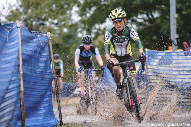 There was a corner flooded with runoff from the pit wash that lended the only mud on the course on Sunday. 2016 KMC Cross Fest Day 2. © Chris McIntosh / Cyclocross Magazine