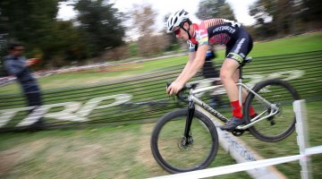 """Ben Gomez Villafane lives up to his name """"Benny hops"""" and hops the barrier. 2016 CXLA Day 2. © Cathy Fegan-Kim / Cyclocross Magazine"""