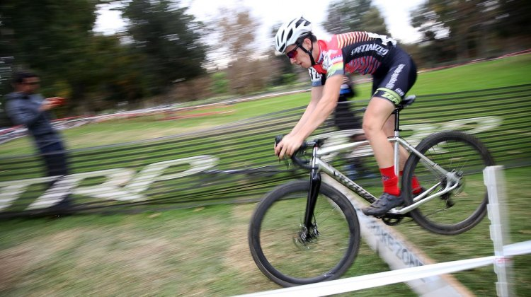 "Ben Gomez Villafane lives up to his name ""Benny hops"" and hops the barrier. 2016 CXLA Day 2. © Cathy Fegan-Kim / Cyclocross Magazine"