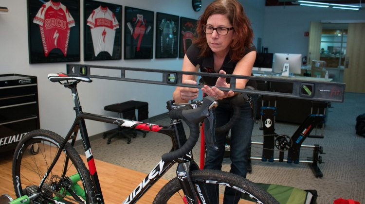 No matter how long you've been racing, a bike fit can be invaluable in addressing physical issues or adapting to a new bike, or aging body. photo: Specialized's Julie Bates helps dial in a bike fit. © Cyclocross Magazine
