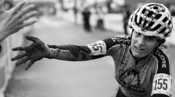 Katie Clouse offers a fan a muddy but victorious high five after a hard-fought win. A look back at the 2016 Cyclocross Nationals' final day. © A. Yee / Cyclocross Magazine