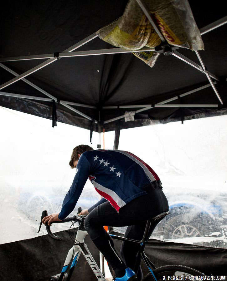 Denzel Stephenson, with his Team USA jacket, spinning his legs on Saturday. 2017 Cyclocross National Championships, © D. Perker / Cyclocross Magazine