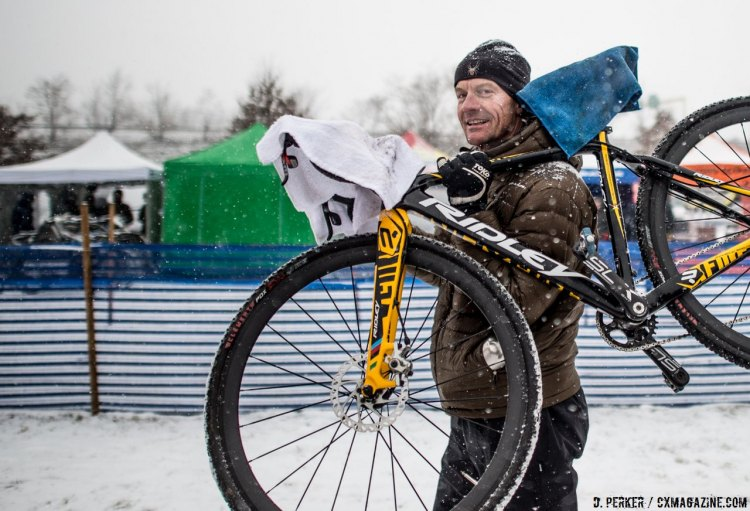 This mechanic had a pro technique to hand new bike to the rider with dry contact points. 2017 Cyclocross National Championships, © D. Perker / Cyclocross Magazine