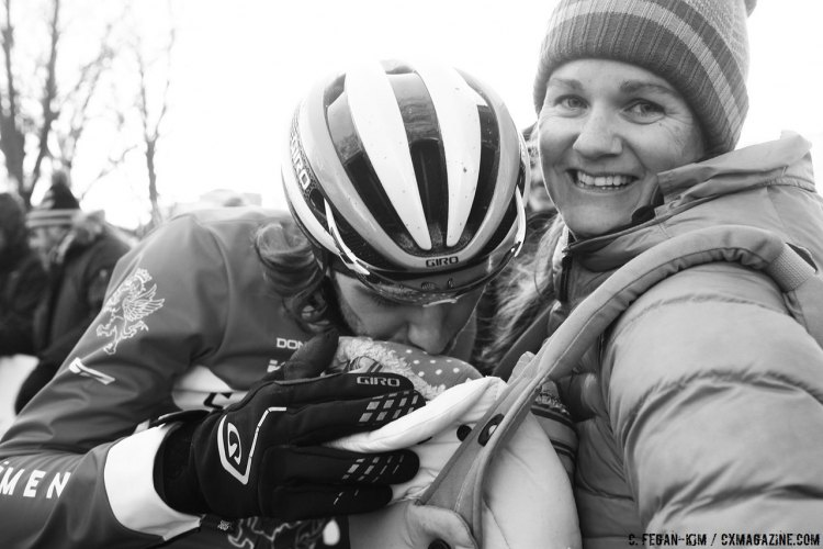 Jamey Driscoll gives his baby daughter a kiss at the finish line. 2017 Cyclocross National Championship, Elite Men. © C. Fegan-Kim / Cyclocross Magazine