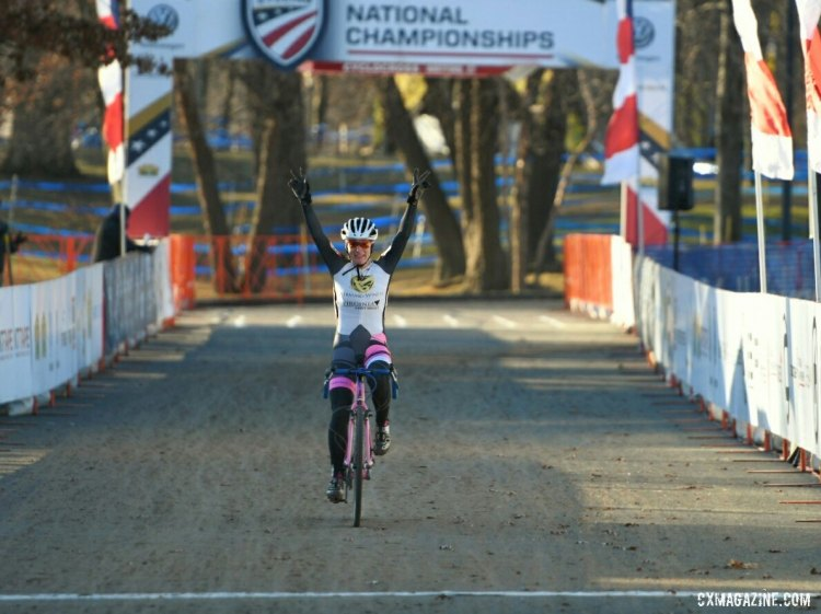 Avanell Schmitz raises her hands in victory at the finish. 2017 Cyclocross National Championships, Masters Women 30-34. © A. Yee / Cyclocross Magazine