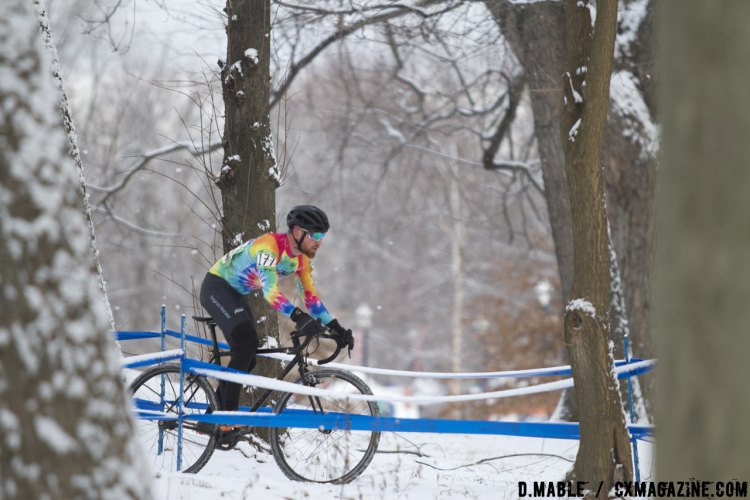 Jacob Huizenga (Chicago Cuttin Crew) stands out against the snowy backdrop with his rainbow tye-die jersey. 2017 Cyclocross National Championships Masters Men 30-34. © D. Mable / Cyclocross Magazine
