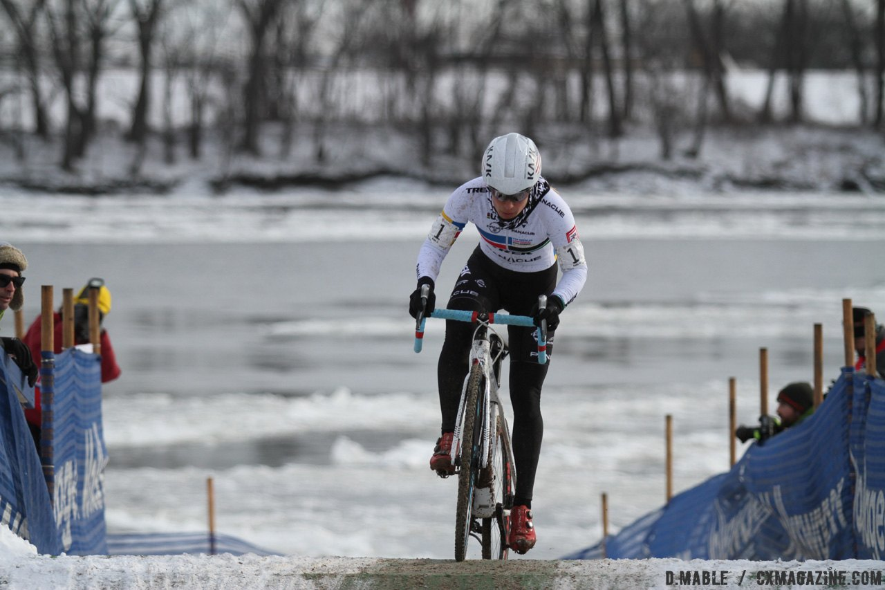 Katie Compton charges the mini-flyover as the nearly-frozen Connecticut River flows slowly behind. 2017 Cyclocross National Championships © D. Mable / Cyclocross Magazine