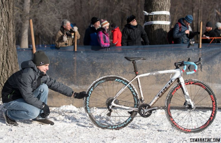 This young junior kindly held Compton's winning bike in place so that we didn't have to shoot a white bike against snow. In the process, he absorbe a bit of knowledge and Compton speed. © Cyclocross Magazine