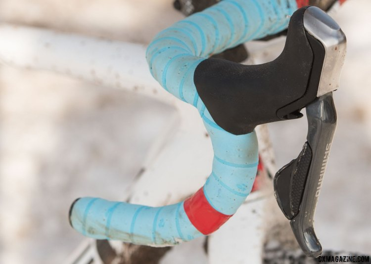 Red electrical tape provides some championship stripes to the bars, but one side was simply to cover up a tear caused by a collision with a post during pre-ride, and the other side is to match and provide visual balance. © Cyclocross Magazine
