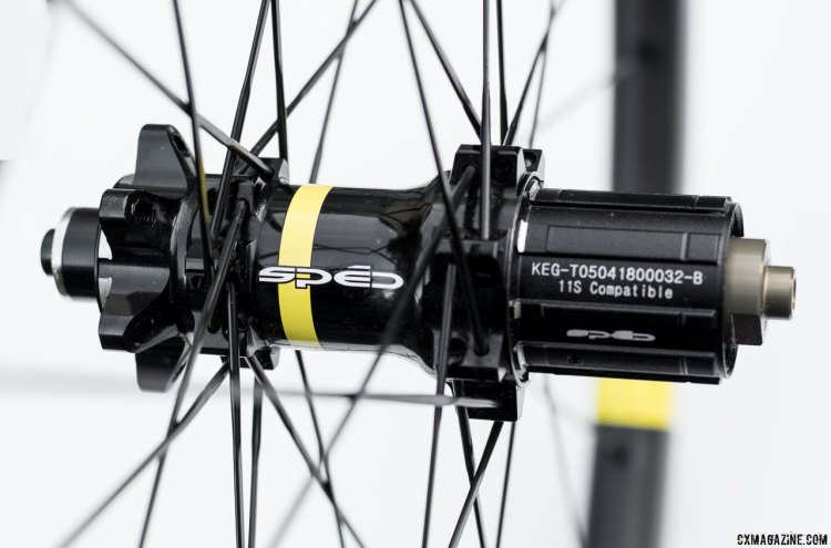 Sped Precision designs its own hubs, and they're glossy handsome units with a touch of a Mavic color scheme. © C. Lee / Cyclocross Magazine