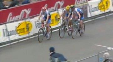 Mario de Clerq and Tom Vannoppen, trade teammates, game plan against Sven Nys at the 2002 World Championships in Zolder.