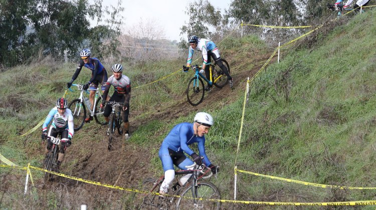 Cyclocross legend and champion John Elgart leads the B field down the course's one prominent hill. Rockville Bike Cyclocross Series, Solano Community College. © John Silva