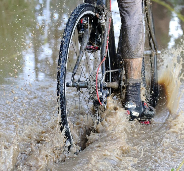 Standing water after heavy rains presents challenges, but beats sitting on a dry couch. Rockville Bike Cyclocross Series, Solano Community College. © John Silva