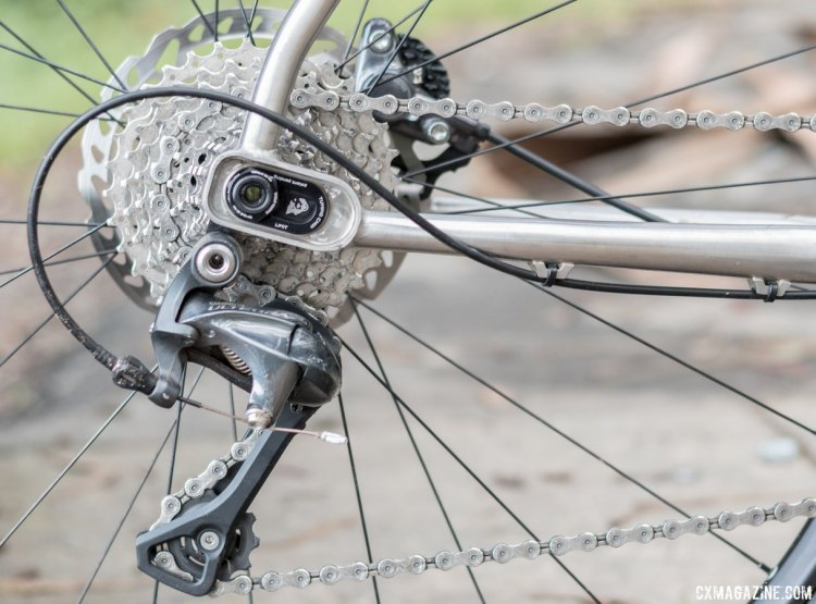 The Tuning Chips allows the rider to slide the rear axle forward or back, changing the wheelbase, BB height, and frame angles slightly. A long cage Shimano derailleur swaps rear gearing on the double chainring drivetrain that surprisingly doesn't feature Wolf Tooth's narrow/wide chainring. Otso Cycle Warakin stainless steel gravel/cyclocross bike. © Cyclocross Magazine