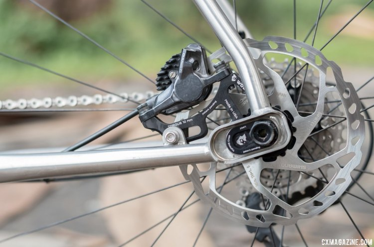 The rear brake caliper moves with the axle as you switch between the two separate positions, but wheel removal for flats isn't tool free. Otso Cycle Warakin stainless steel gravel/cyclocross bike. © Cyclocross Magazine