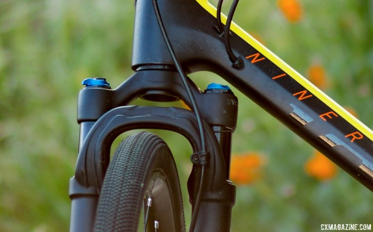 Clearance is tight but a thicker crown race keeps the knobs from hitting the down tube on our carbon Niner RLT. The 32 Step-Cast AX (Adventure Cross) suspension fork for gravel bikes. © Cyclocross Magazine