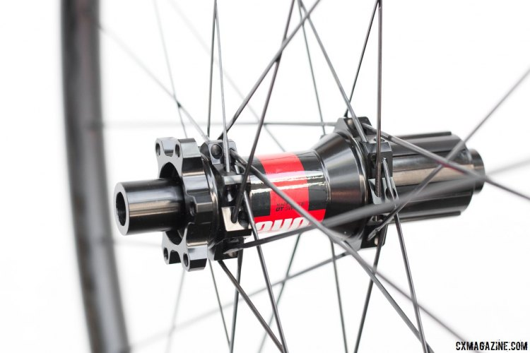 The 240s hubs offer different axle configurations with swappable caps, and customers can pick from Centerlock and 6-bolt rotor mounts and Shimano/SRAM or XD drivers. Knight Composites 29 Race / Gravel carbon tubeless disc wheelset. © Cyclocross Magazine