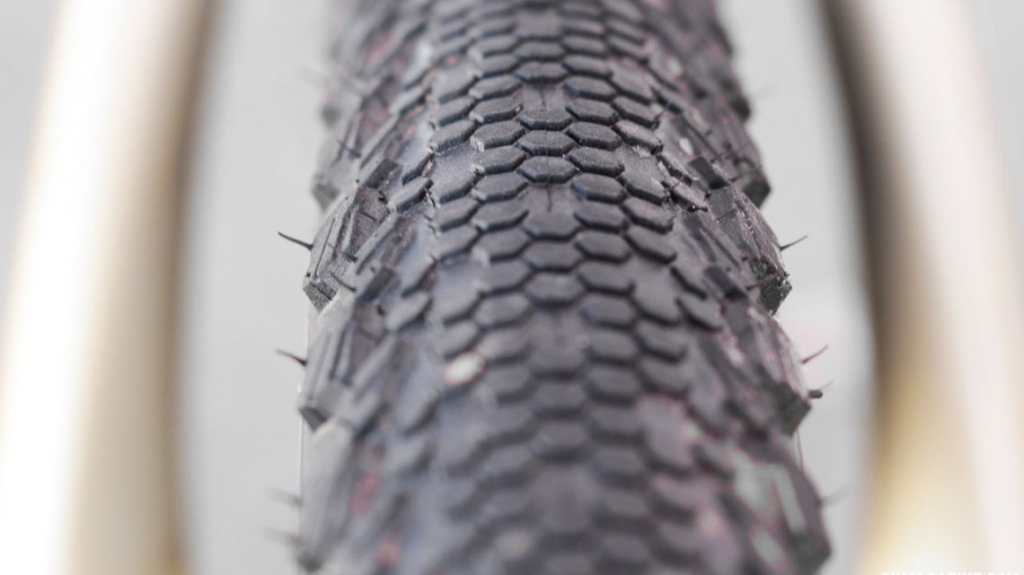 Vittoria's new 40c Terreno TNT Tubeless tires features a fish scale-like Dry conditions tire that has a smoother leading edge and a trailing edge that bites in during braking. The tread features three different knob heights, increasing in height as you move to the shoulders. 2017 Sea Otter Classic. © Cyclocross Magazine