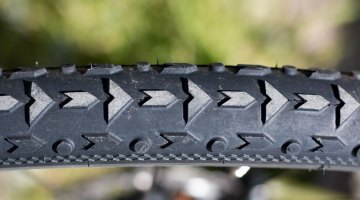 "Vittoria's new 40c ""Mix"" conditions Terreno TNT Tubeless tire features a unique ribbon below the side knobs for added rigidity. 2017 Sea Otter Classic. © Cyclocross Magazine"