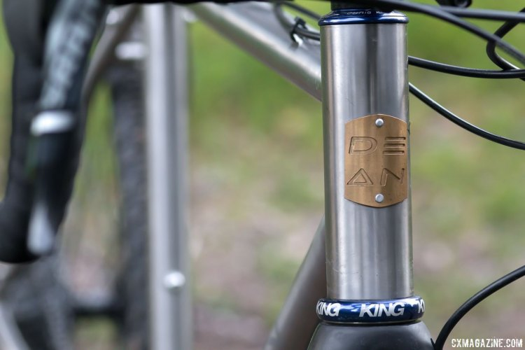 A metal head badge on the 44mm head tube keeps things classy. Dean Antero titanium cyclocross bike. © Cyclocross Magazine