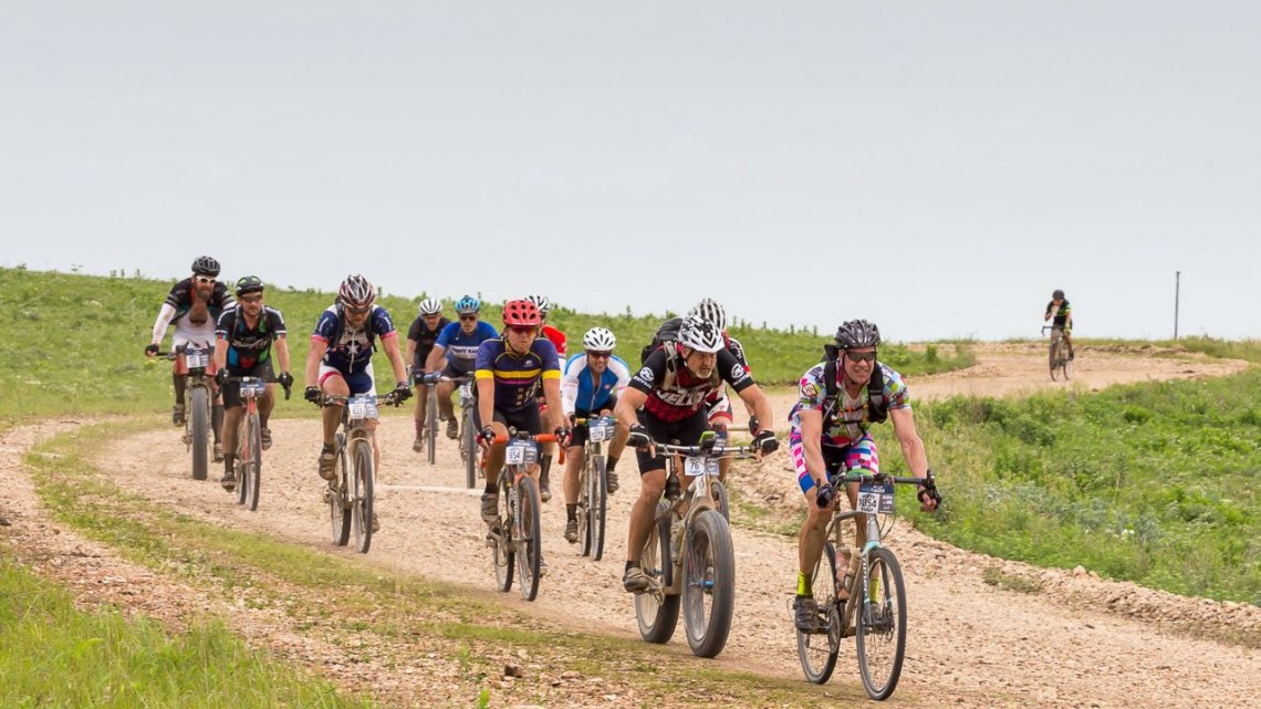 The pack of the DK200 in Chase County, Kansas. 2017 Dirty Kanza gravel race. © Christopher Nichols