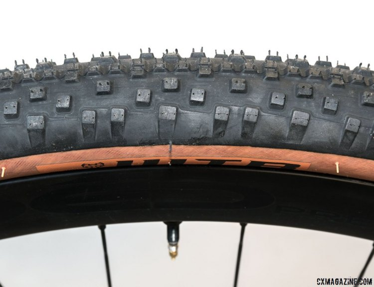 The side knobs are buttressed and tapered to avoid squirm when cornering on the road. WTB Resolute 42 gravel tire. © Cyclocross Magazine