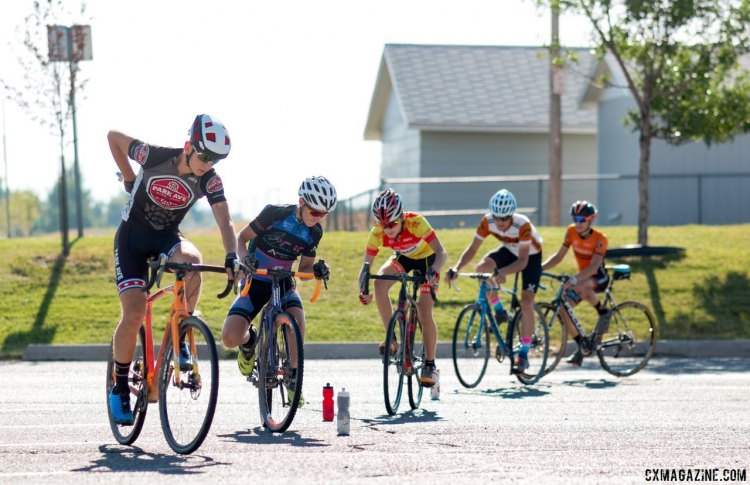 Campers work on their on-the-bike agility, including reaching down to grab their water bottles. 2017 Montana Cross Camp © Cyclocross Magazine