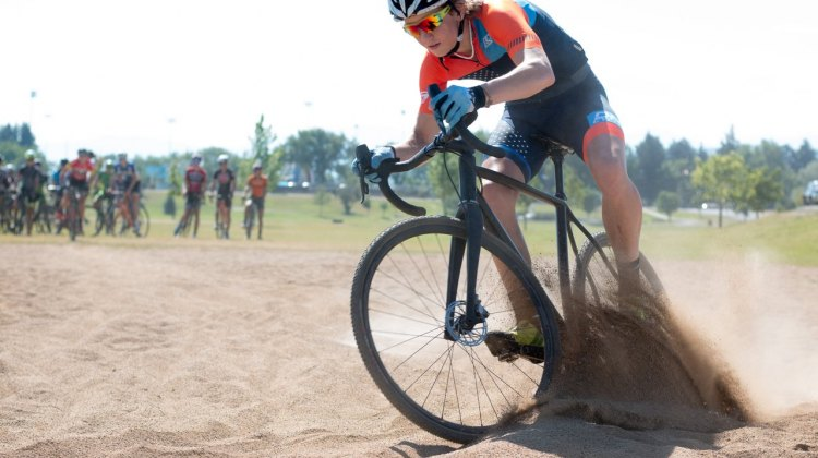 Kelton Williams digs in on his way to the sand hairpin turn. 2017 Montana Cross Camp © Cyclocross Magazine
