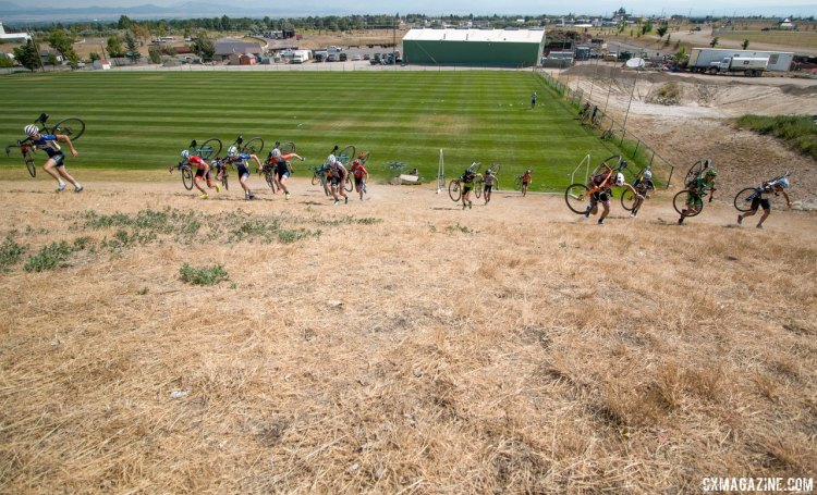 Campers run this hill with their bikes before wrapping up the skills work and heading to lunch. 2017 Montana Cross Camp © Cyclocross Magazine