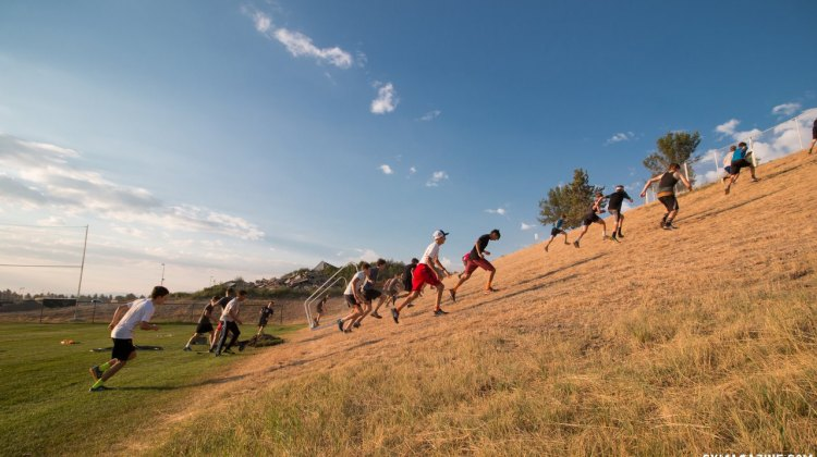 The morning workout has a lot of running, including a cross country warm-up, stadium stairs, and hills repeats as seen here. 2017 Montana Cross Camp © Cyclocross Magazine