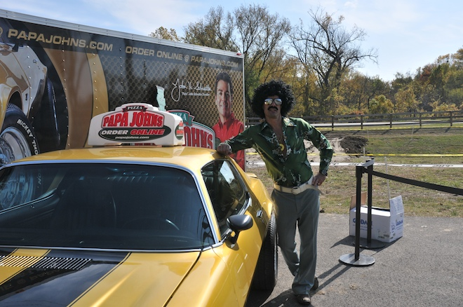 Bob Bobrow in the 70's disco mode poses with Papa John's orginal Camaro at Storm The Greens Cyclocross Race, Louisville, KY October 30, 2011