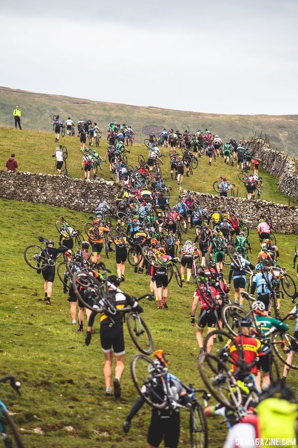 The Three Peaks course is known for having several sections that are only passable by foot. Here, riders scramble up an unrideable hill. 2017 Three Peaks Cyclocross. © D. Monaghan / Cyclocross Magazine