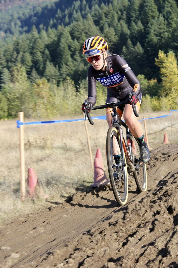 Team S&M's Clara Hosinger rides away from the Eagle Creek Fire burn that made national news. CX Crusade Cascade Locks. Photo M. Estes