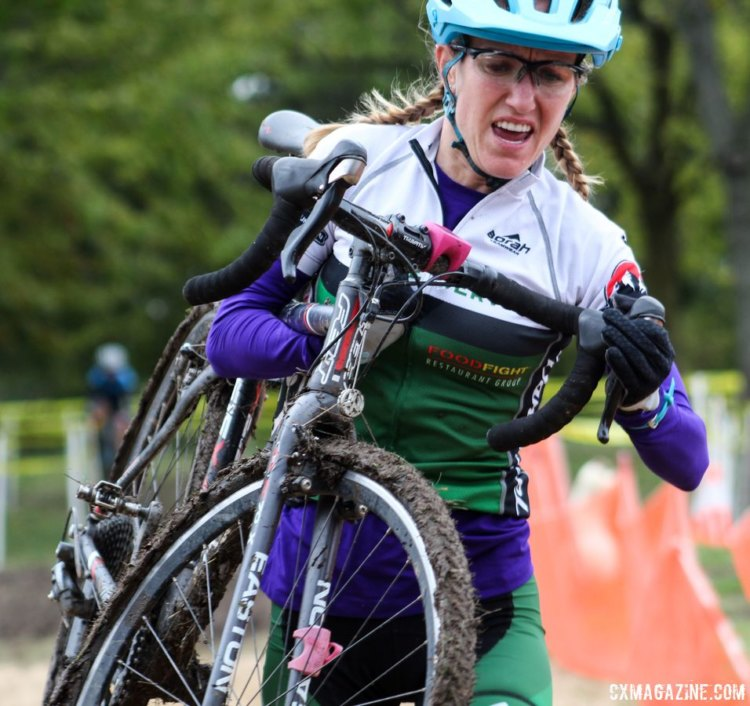 Holly LaVesser carries her bike through the sand. 2017 Fitcherona Cross Omnium - McGaw Park. © Z. Schuster / Cyclocross Magazine