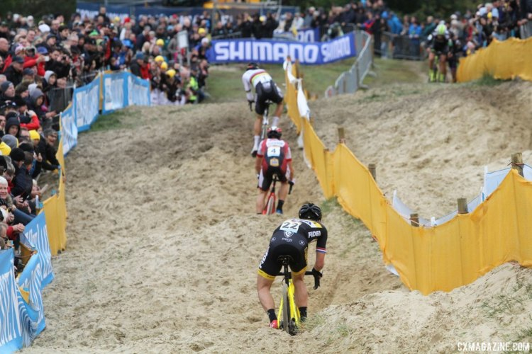 Wout van Aert, Lars van der Haar and Laurens Sweeck work to stay upright in the sane. 2017 World Cup Koksijde. © B. Hazen / Cyclocross