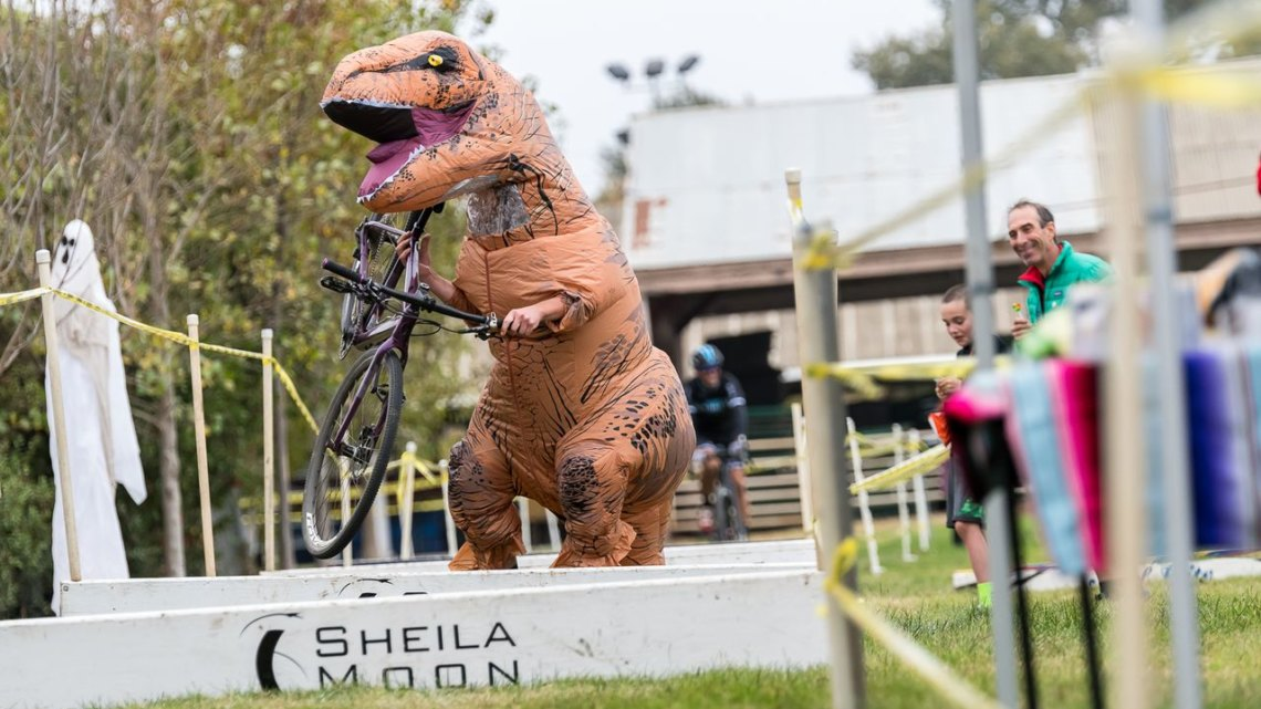 T Rex shows everyone how to run the barriers with baby arms. 2017 Surf City Cyclocross © J. Vander Stucken / Cyclocross Magazine