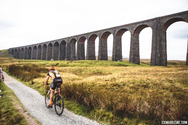 Rider pass along the Ribblehead Viaduct built in the 1870s. 2017 Three Peaks Cyclocross. © D. Monaghan / Cyclocross Magazine