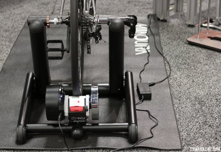 Minoura's new wheel-on Kogura Smart Trainer could be the most portable, cyclocross warm-up friendly smart trainer. It will also save you the cost of a cassette compared to wheel-off trainers but could speed up tire wear if you don't use a spare wheel on race day. Interbike 2017 © Cyclocross Magazine