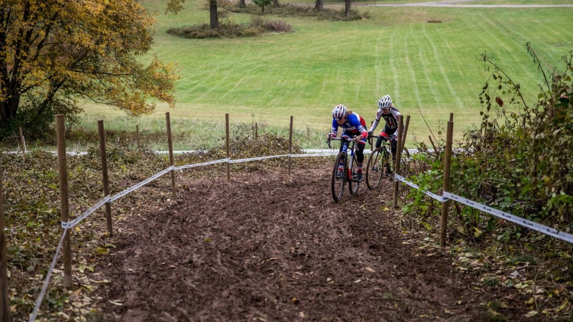 Caroline Mani and Christel Ferrier-Bruneau grind their way up the first of three muddy climbs. 2017 Derby City Cup. © D. Perker / Cyclocross Magazine