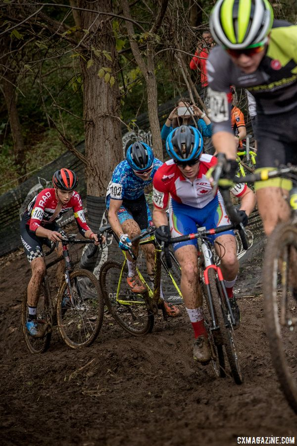 Junior Men ride through the muddy ditch during the first lap. 2017 Derby City Cup. © D. Perker / Cyclocross Magazine
