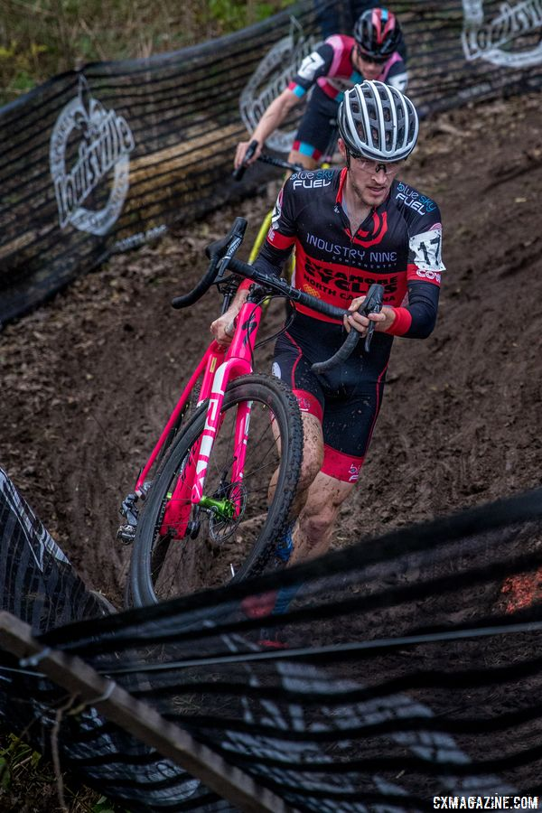 Tristan Cowie runs through the muddy ditch before the finishing straight. 2017 Derby City Cup. © D. Perker / Cyclocross Magazine