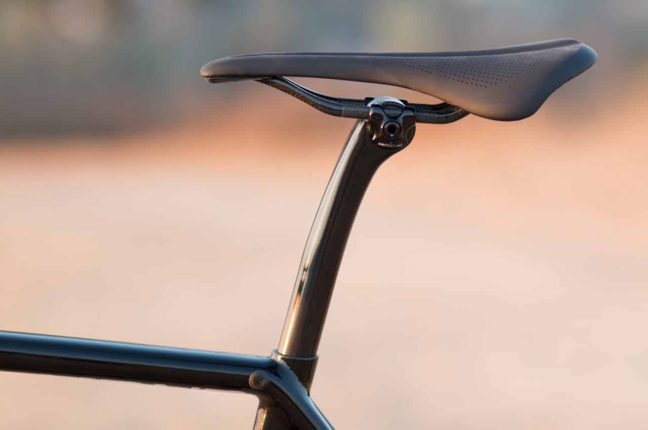 The elegant, one-bolt seat post, carbon rail clamp and carbon rail saddle are perhaps the biggest misses for a pure cyclocross race bike. The angle slipped on remounts when torqued to spec and well over spec. We replaced with a traditional two-bolt (front/rear) post. 2018 Specialized S-Works CruX cyclocross bike, with Shimano Dura-Ace 9100. © Cyclocross Magazine