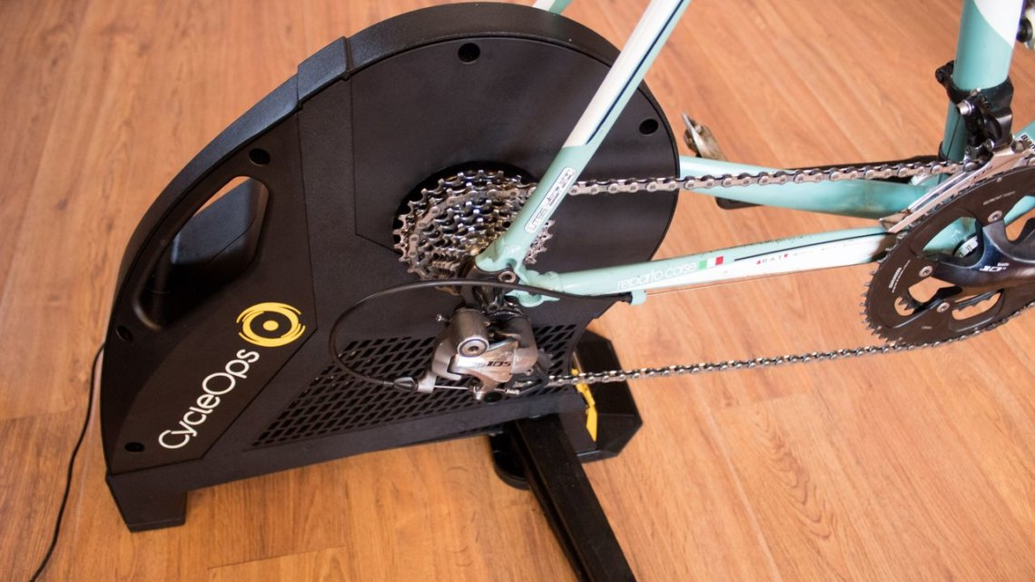 The large flywheel housed in the body of the Hammer allows it to simulate grades up to a leg-busted 20%. CycleOps Hammer direct-drive smart trainer. © Z. Schuster / Cyclocross Magazine