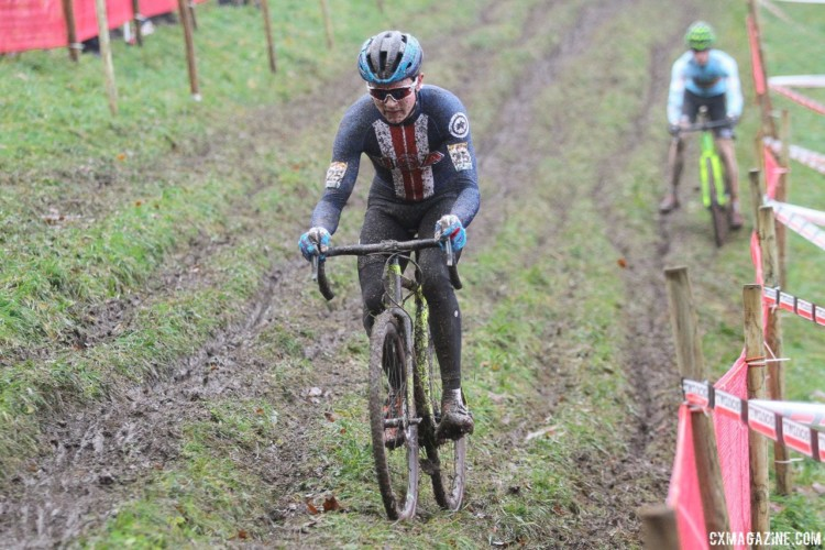 Lane Maher focuses through the mud spraying everywhere. 2017 World Cup Namur. © B. Hazen / Cyclocross Magazine