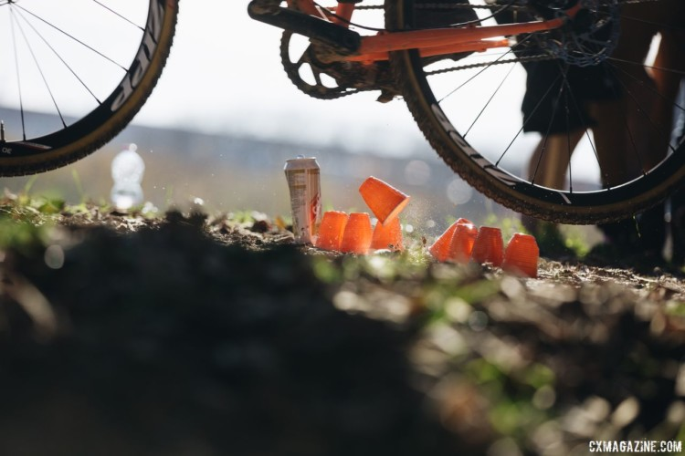 Discarded cups do not a barrier make, but this rider still used them as an excuse to get a little air. 2017 SSCXWCITA, Verona, Italy. © F. Bartoli Avveduti / Cyclocross Magazine