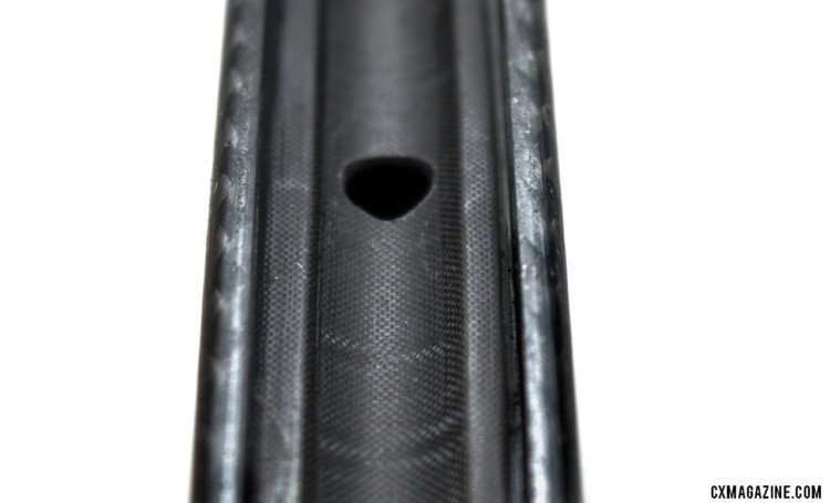This is the only hole in the rim when you opt for the $100 no spoke hole option. The weight gain is lighter than tubeless tape and eliminates tape issues at the expense of easy nipple replacement. It's worth noting that despite tough riding, haven't broken a spoke. FSE (Filament Spin Evolution) EVO 35CD carbon tubeless clincher disc brake wheels. © Cyclocross Magazine