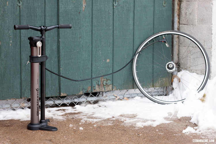 The Blackburn Chamber Tubeless Floor Pump's 4-foot-long hose keeps keeps your wheel far away as you attempt to seat your tubeless tire. It also can reach a bike on a car rack or in a repair stand. © Cyclocross Magazine