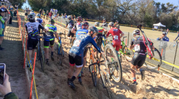 The men tackle the long sand pit. 2017 Resolution Cross Cup Day 1. photo: Heather Sawtelle / Peloton
