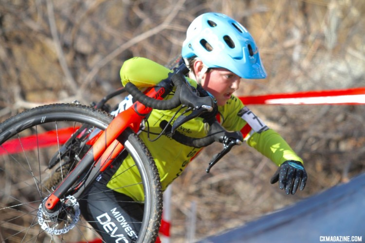 a young rider shoulders his bike. Junior Men 11-12. 2018 Cyclocross National Championships. © D. Mable/ Cyclocross Magazine